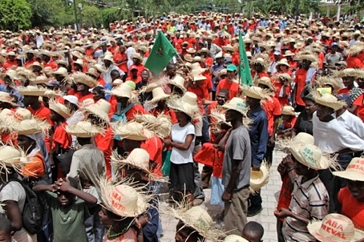 "Haitians protest Monsanto seed ""contribution""."