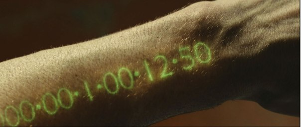 Movie: In time Time is money, and in this movie, time is you life, when this clock reads 0 you are dead.
