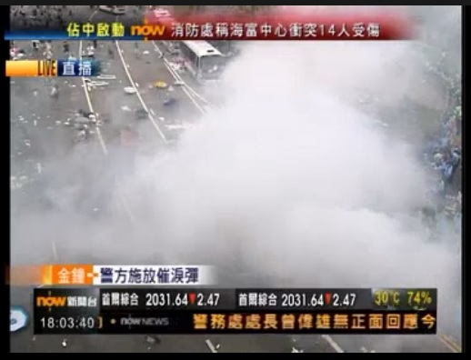 Hong Kong Police use several rounds of tear gas. Most protesters remain crowds estimated to be as many as 30,000.